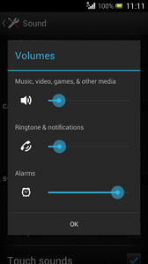 To decrease the volume of the alarm, move the slider for Alarms to the left.